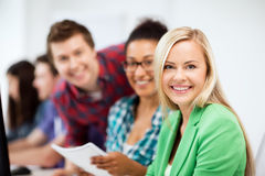 Students with computer studying at school. Education, technology and internet - students with computer studying at school Royalty Free Stock Photography
