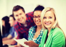 Students with computer studying at school. Education, technology and internet - students with computer studying at school Royalty Free Stock Photo