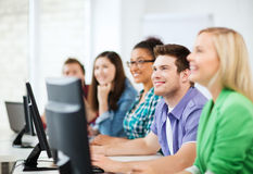 Students with computers studying at school. Education concept - students with computers studying at school Royalty Free Stock Image