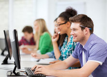 Students with computers studying at school Stock Image