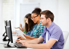 Students with computers studying at school. Education concept - student with computers studying at school Royalty Free Stock Images