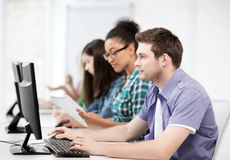 Students with computers studying at school. Education concept - student with computers studying at school Royalty Free Stock Photography