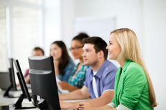 Students with computers studying at school. Education, technology and internet - students with computers studying at school Royalty Free Stock Image