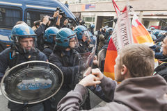 Students confronting police in Milan, Italy. MILAN, ITALY - NOVEMBER 13: Students confront police during a march in the city streets to protest agaist the public Royalty Free Stock Photography