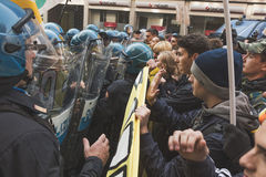 Students confronting police in Milan, Italy. MILAN, ITALY - NOVEMBER 13: Students confront police during a march in the city streets to protest agaist the public Stock Photography
