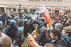 Students confronting police in Milan, Italy. MILAN, ITALY - NOVEMBER 13: Students confront police during a march in the city streets to protest agaist the public Royalty Free Stock Images