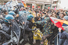 Students confronting police in Milan, Italy. MILAN, ITALY - NOVEMBER 13: Students confront police during a march in the city streets to protest agaist the public Royalty Free Stock Image