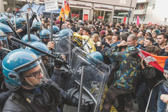 Students confronting police in Milan, Italy. MILAN, ITALY - NOVEMBER 13: Students confront police during a march in the city streets to protest agaist the public Stock Photo