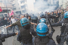 Students confronting police in Milan, Italy. MILAN, ITALY - NOVEMBER 13: Students confront police during a march in the city streets to protest agaist the public Royalty Free Stock Photo