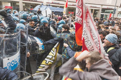 Students confronting police in Milan, Italy. MILAN, ITALY - NOVEMBER 13: Students confront police during a march in the city streets to protest agaist the public Stock Photos
