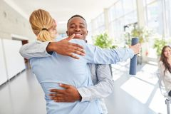 Students congratulate each other after completion. Students congratulate each other after university diploma completion stock image