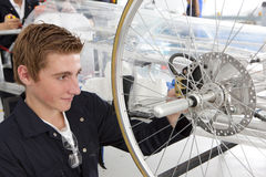 Students constructing electric vehicle prototype in vocational school Stock Image