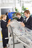 Students constructing electric vehicle prototype in vocational school Royalty Free Stock Photo