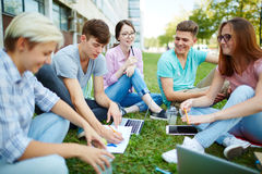 Students consulting Stock Photo