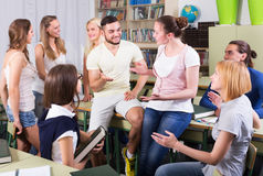 Students conversation in the classroom Stock Images