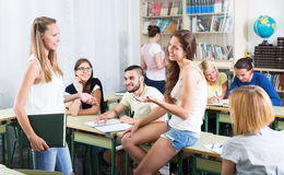 Students conversation in the classroom Royalty Free Stock Photo