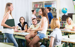 Students conversation in the classroom Stock Photo