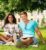 Students couple in a city park Stock Images