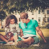 Students couple in a city park Stock Photos