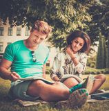 Students couple in a city park Royalty Free Stock Photography