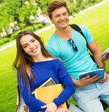 Students couple in a city park Royalty Free Stock Photo