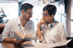 Students couple in school studying for exams together Royalty Free Stock Photo