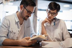 Students couple in school studying for exams together Stock Photography