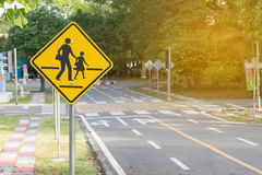 Students crossing ahead sign. Closeup royalty free stock photo