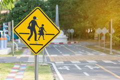 Students crossing ahead sign. Closeup stock image