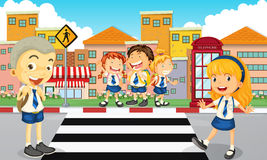 Students crossing the road Royalty Free Stock Images