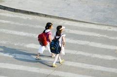 STUDENTS CROSSING STREET stock photos