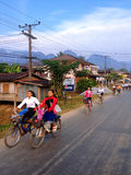 Students cycling go to school Royalty Free Stock Image