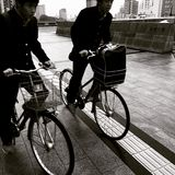 Students cycling in Hiroshima Japan Royalty Free Stock Image