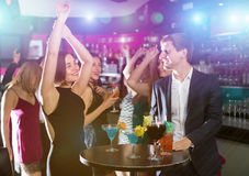 Students dancing on celebratory party. Young students dancing on celebratory party with cocktails in the club Stock Photography