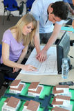 Students in design course. Couple of young adults attending a design course Royalty Free Stock Photos
