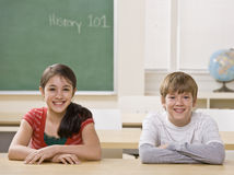 Students at desk in classroom Royalty Free Stock Images