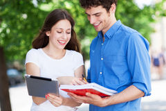 Students with digital tablet and notebooks Stock Image