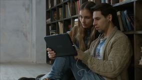 Students with digital tablet studying together stock footage