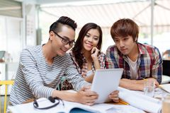 Students with digital tablet Royalty Free Stock Image