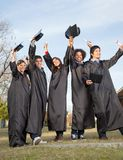 Students With Diplomas Celebrating Success On Stock Photography