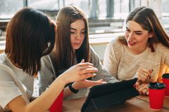 Students discussing media content using tablet Royalty Free Stock Images