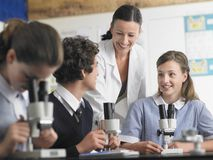Students In Discussion With Teacher Stock Photo