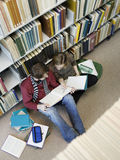 Students Doing Homework On Floor In Library Royalty Free Stock Photography
