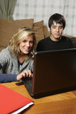 Students doing homework at home Royalty Free Stock Image