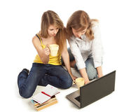 Students doing homework together Royalty Free Stock Images