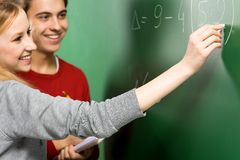 Students Doing Math on Chalkboard Stock Image