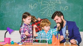 Students doing science experiments with microscope in lab. school kids scientist studying science. happy children stock photos