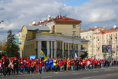 Students dressed in red walk in Moscow Royalty Free Stock Image