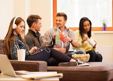 Students with drinks and popcorn Stock Images