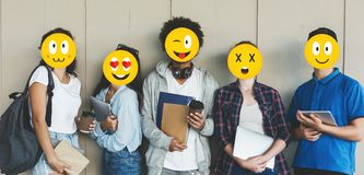Students with emoji faces holding books over grey background stock photography